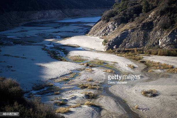 The San Gabriel River winds through the dry upper reaches of San Gabriel Reservoir in the Angeles National Forest on January 22 2014 in near Azusa...