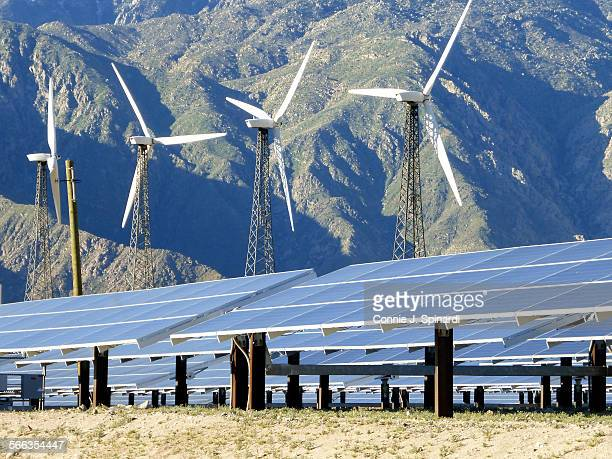 The San Gorgonio Pass Palm Springs CA Solar panels and wind turbines with the San Jacinto Mountains in the background