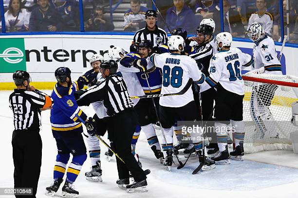 The San Jose Sharks and the St Louis Blues fight during the first period in Game Two of the Western Conference Final during the 2016 NHL Stanley Cup...