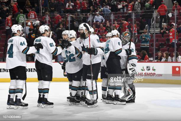 The San Jose Sharks celebrate after defeating the Chicago Blackhawks 73 at the United Center on December 16 2018 in Chicago Illinois