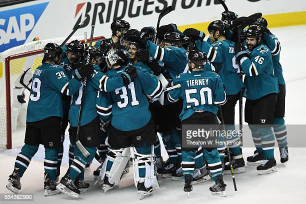 The San Jose Sharks celebrate after defeating the St. Louis Blues 5-2 in Game Six of the Western Conference Final to advance to the the 2016 NHL...