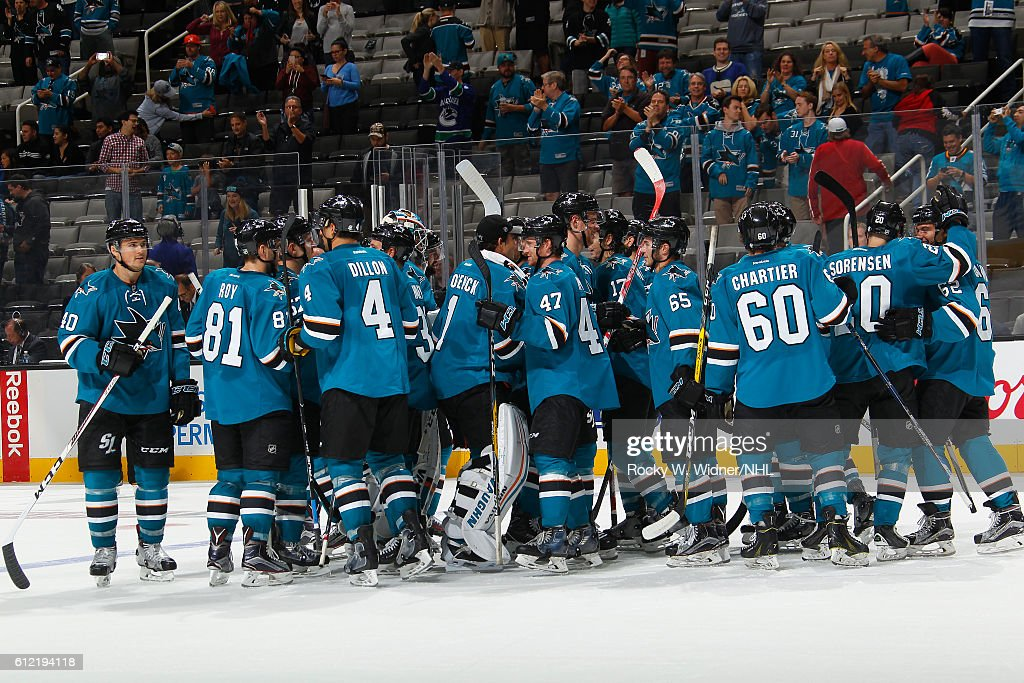 The San Jose Sharks celebrate after defeating the Vancouver Canucks at SAP Center on September 27, 2016 in San Jose, California.