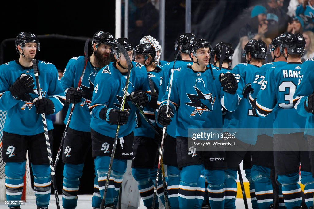 The San Jose Sharks celebrate after defeating the Vancouver Canucks at SAP Center on February 15, 2018 in San Jose, California.