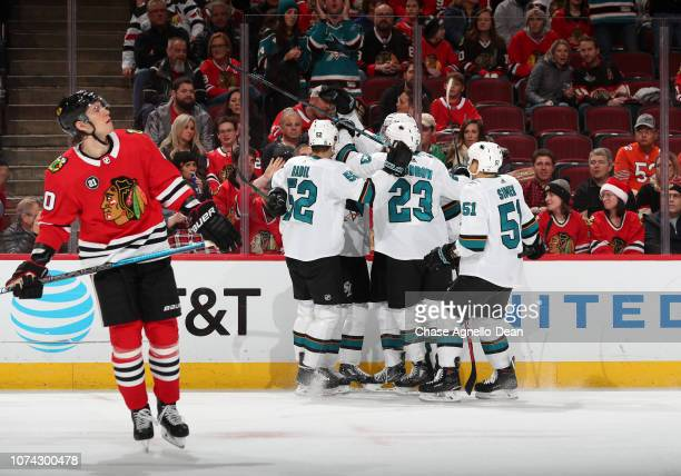 The San Jose Sharks celebrate after scoring against the Chicago Blackhawks in the first period at the United Center on December 16 2018 in Chicago...