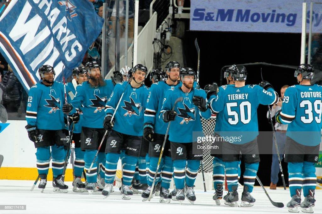 The San Jose Sharks celebrate their win over the Nashville Predators at SAP Center on November 1, 2017 in San Jose, California. The Sharks defeated the Predators 4-1.