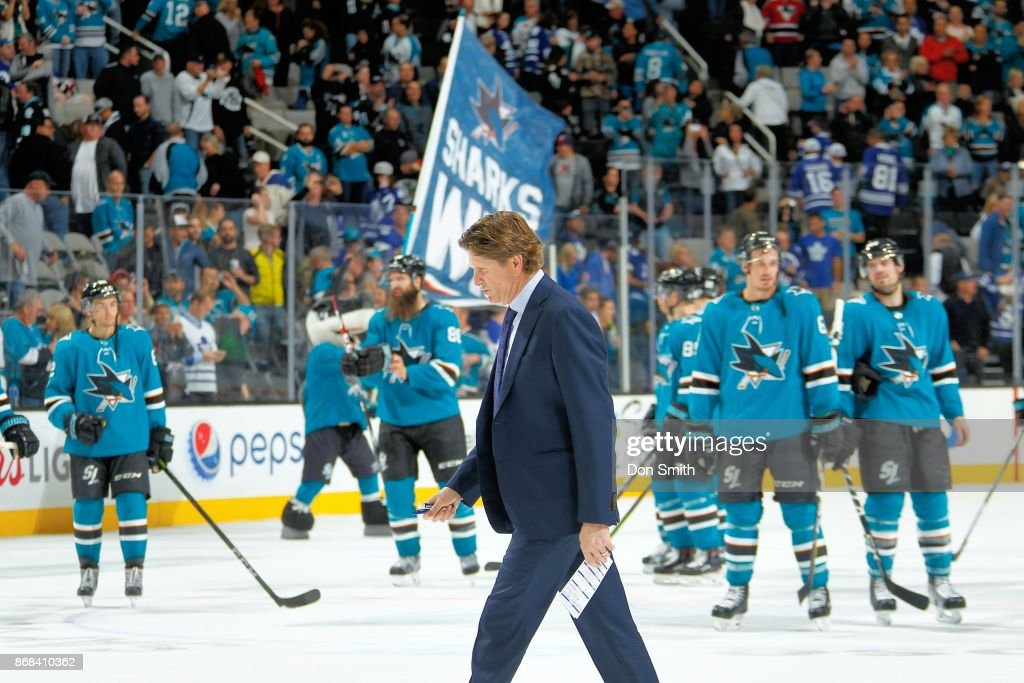 The San Jose Sharks celebrate their win over the Toronto Maple Leafs as Head Coach, Mike Babcock of the Toronto Maple Leafs walks off the ice at SAP Center on October 30, 2017 in San Jose, California. The Sharks defeated the Maple Leafs 3-2.
