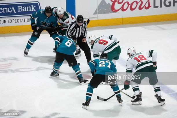 The San Jose Sharks faceoff against the Minnesota Wild at SAP Center on April 7 2018 in San Jose California