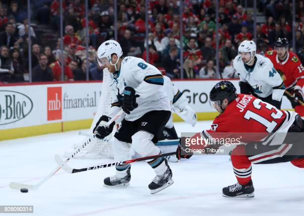 The San Jose Sharks' Joe Pavelski controls the puck ahead of the Chicago Blackhawks' Tomas Jurco at the United Center in Chicago on February 23 2018...