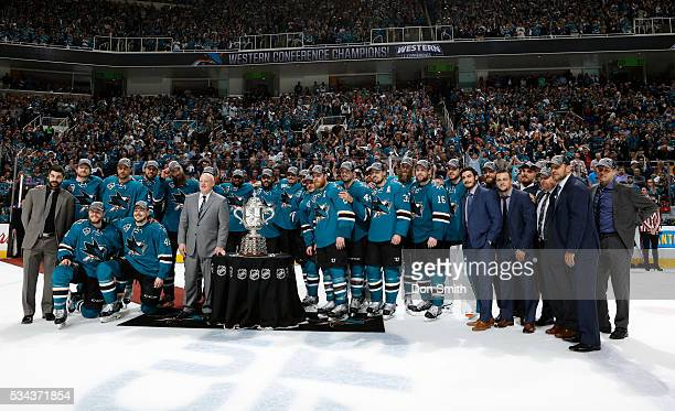 The San Jose Sharks pose around the Clarence S Campbell Bowl after winning against the St Louis Blues in game six of the Western Conference Finals...