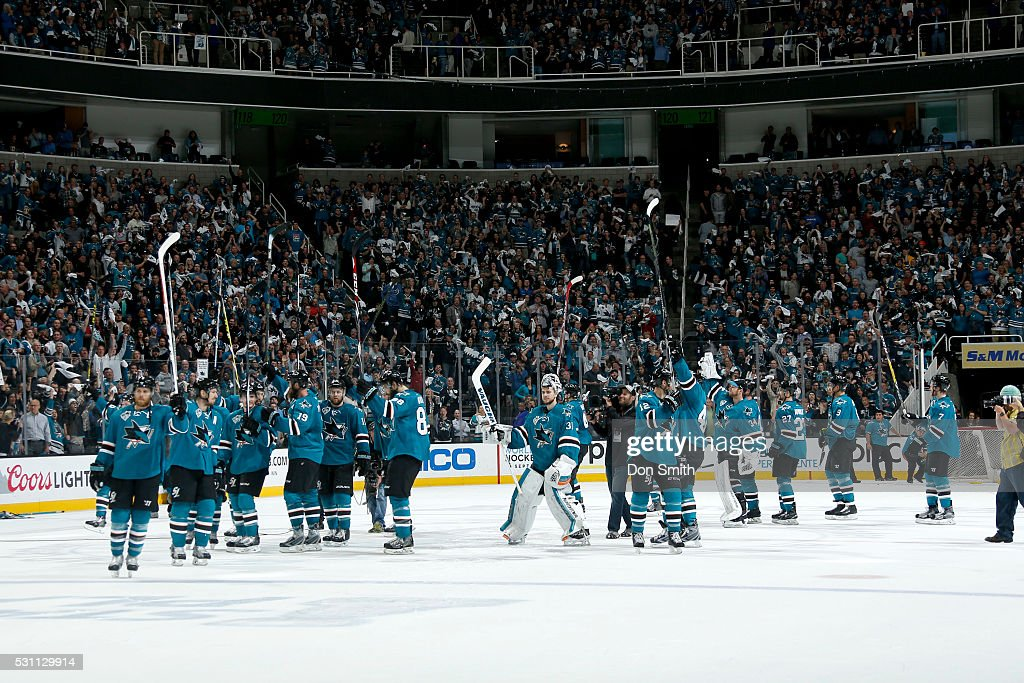 The San Jose Sharks raise their sticks to the crowd celebrating their series win the Nashville Predators in game seven of the Western Conference Second Round during the 2016 NHL Stanley Cup Playoffs at the SAP Center at San Jose on May 12, 2016 in San Jose, California.