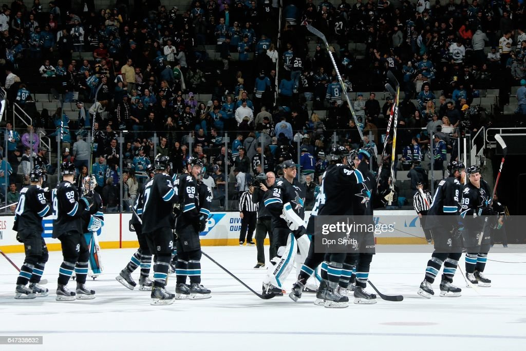 The San Jose Sharks salute the crowd after their win against the Vancouver Canucks at SAP Center at San Jose on March 2, 2017 in San Jose, California. The Sharks defeated the Canucks 3-1.
