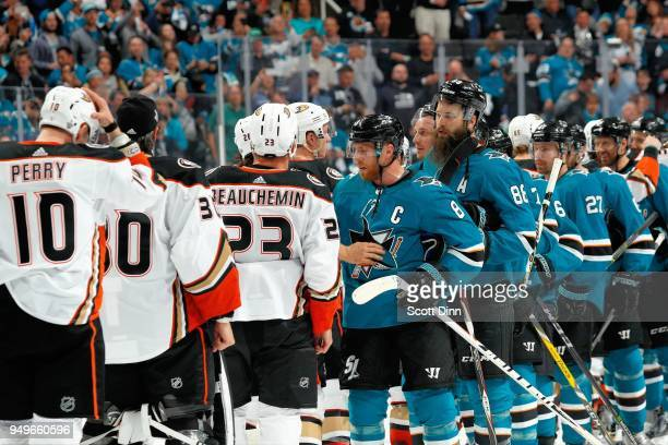The San Jose Sharks shake hands with the Anaheim Ducks after the Sharks sweep the Ducks to win the Western Conference First Round in Game Four of the...