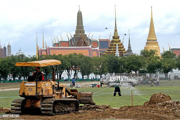 The Sanam Luang or Royal Field outside the Royal Palace in Bangkok. A new grass lawn is being laid on top of a concrete foundation. Part of a Bangkok...