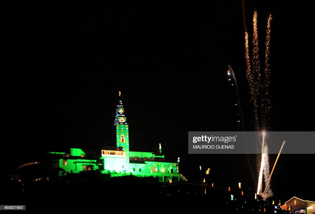 The sanctuary of Monserrate is illuminated with Christmas lights in Bogota on November 28, 2008. Monserrate, a pilgrim destination and tourist attraction, is located on one of highest hills of the city. AFP PHOTO/Mauricio DUEÑAS /