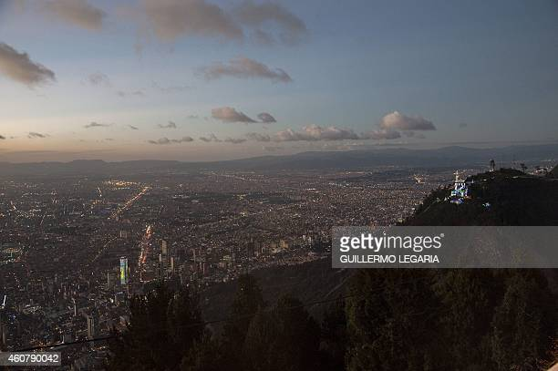 The sanctuary of the Basilica of the Fallen Lord of Montserrate is illuminated with Christmas lights in Bogota on December 22 2014 Monserrate a...