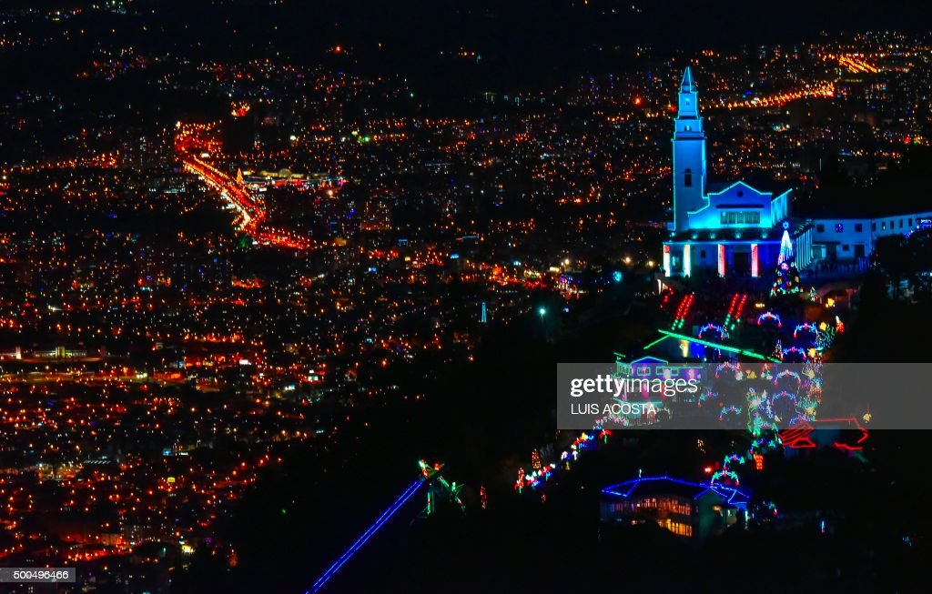The sanctuary of the Basilica of the Fallen Lord of Montserrate is seen illuminated for Christmas in Bogota on December 8, 2015. The basilica, a pilgrim destination and tourist attraction, is located on Montserrate, one of highest hills of the city. AFP PHOTO/Luis Acosta /
