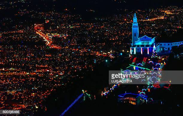 The sanctuary of the Basilica of the Fallen Lord of Montserrate is seen illuminated for Christmas in Bogota on December 8 2015 The basilica a pilgrim...
