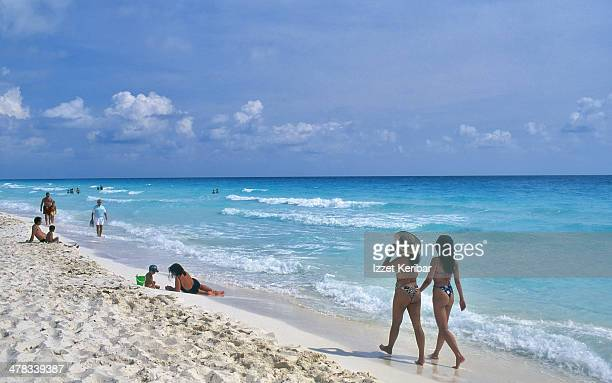 The sandy beach and emerald sea at Cancun