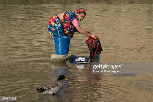 The Sangu River is used for local villagers to do their laundry, even in larger towns like Bandarban. They carry their clothes in baskets and use...