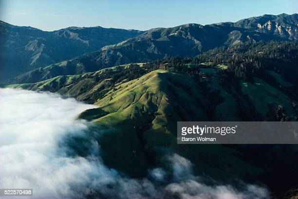 The Santa Lucia Mountains rise abruptly from the Pacific Ocean, Big Sur, CA, United States, circa 1970s.
