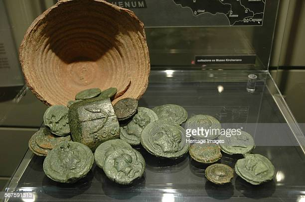 The Santa Marinella coin hoard A large cooking vessel was employed as the container for the hoard consisting of one bronze currency bar and 17 pieces...