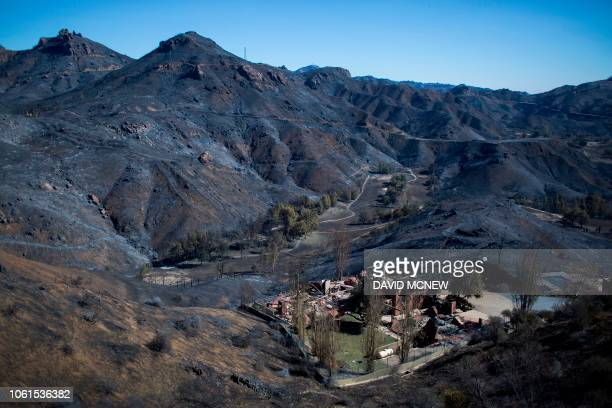 TOPSHOT The Santa Monica Mountains are seen left blackened by the Woolsey Fire near Malibu California on November 14 2018 Firefighters backed by air...