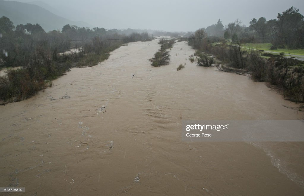 Record rains drench californias central coast pictures getty images the santa ynez river usually a dry river bed is flowing fast and nearing freerunsca Gallery