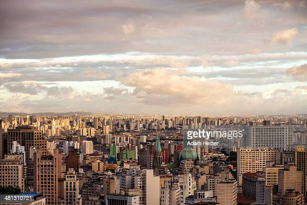 The Sao Paulo skyline at sunset with clouds.