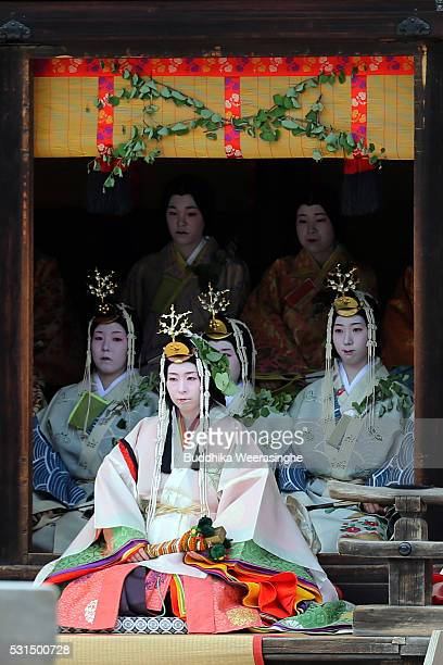 The 'SAoidai' queen principle figure of festival wearing a 12layered ceremonial kimono of Heian Period court ladies called Junihitoe sits on stage in...