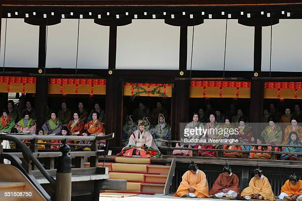The 'SAoi-dai' queen, principle figure of festival wearing a 12-layered ceremonial kimono of Heian Period court ladies called Junihitoe, sits on...