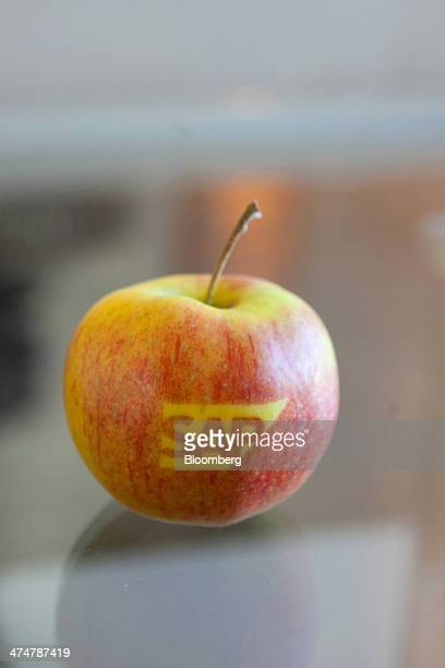 The SAP AG company logo sits on a branded eating apple inside the businesssoftware maker's headquarters in Walldorf Germany on Monday Feb 24 2014 SAP...