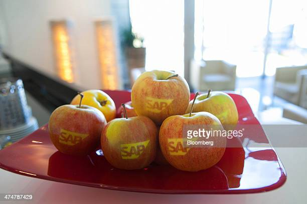 The SAP AG company logo sits on branded eating apples inside the businesssoftware maker's headquarters in Walldorf Germany on Monday Feb 24 2014 SAP...