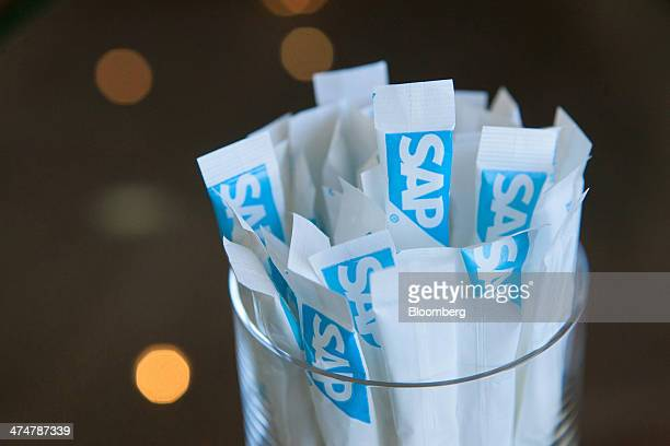 The SAP AG company logo sits on branded sachets of sugar inside the businesssoftware maker's headquarters in Walldorf Germany on Monday Feb 24 2014...