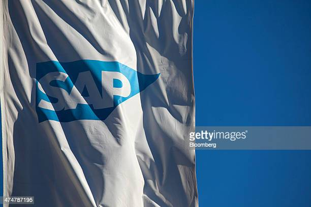 The SAP AG logo sits on a banner flying outside the businesssoftware maker's headquarters in Walldorf Germany on Monday Feb 24 2014 SAP AG coChief...