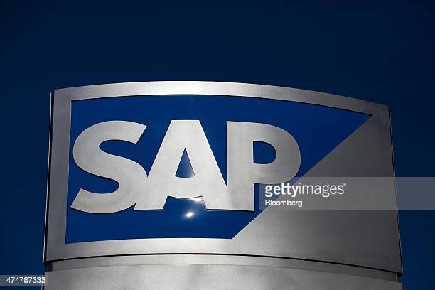 The SAP AG logo sits on a sign standing outside the businesssoftware maker's headquarters in Walldorf Germany on Monday Feb 24 2014 SAP AG coChief...
