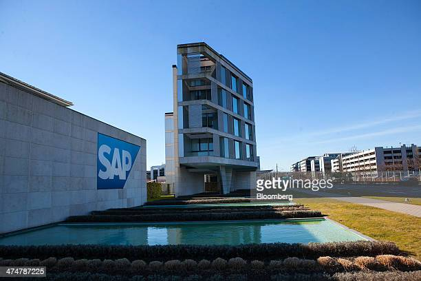 The SAP AG logo sits on display beside a water feature outside the businesssoftware maker's headquarters in Walldorf Germany on Monday Feb 24 2014...