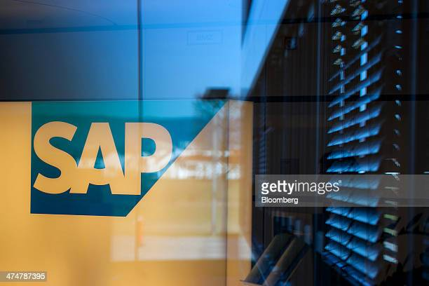 The SAP AG logo sits on display inside an office in the businesssoftware maker's headquarters in Walldorf Germany on Monday Feb 24 2014 SAP AG...
