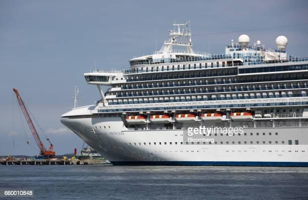 The Sapphire Princess cruise ship operated by Princess Cruise Lines Ltd sits moored at the Hakata Port International Terminal in Fukuoka Japan on...