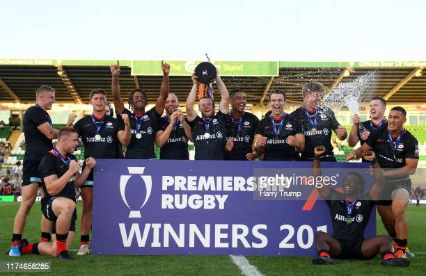 The Saracens side celebrate after winning the Trophy Final during Day Two of the Premiership Rugby 7s Series at Franklin's Gardens on September 14,...