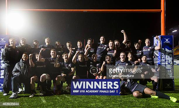 The Saracens team celebrate winning the final during the Premiership Rugby/RFU U18 Academy Finals Day match between Northampton Saints and Saracens...