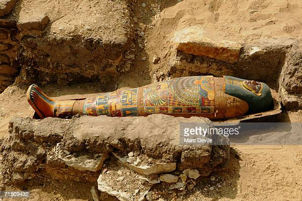 The sarcophagus of a rich merchant lies in the desert sand on August 2005 in Giza Egypt The Council chief Zahi Hawass says the sarcophagus is about...
