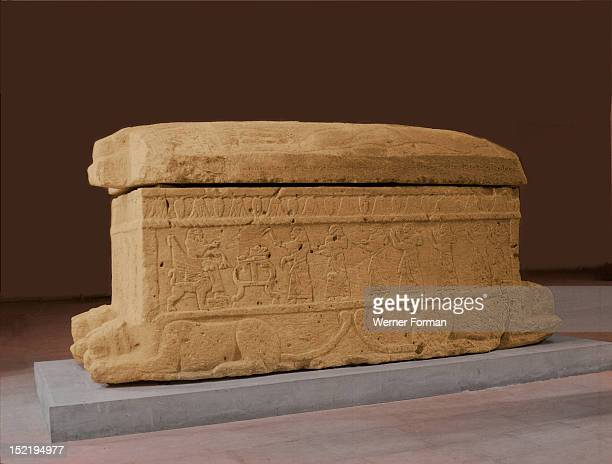 The sarcophagus of King Ahiram, Commissioned by Ahirams son Itthobaal, it depicts a funerary banquet scene showing the king seated on his throne...