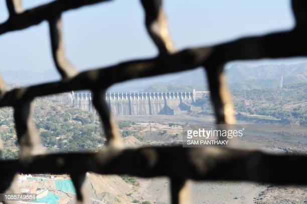 The Sardar Sarovar Narmada dam is seen from the viewing gallery inside the Statue Of Unity the world's tallest statue dedicated to Indian...
