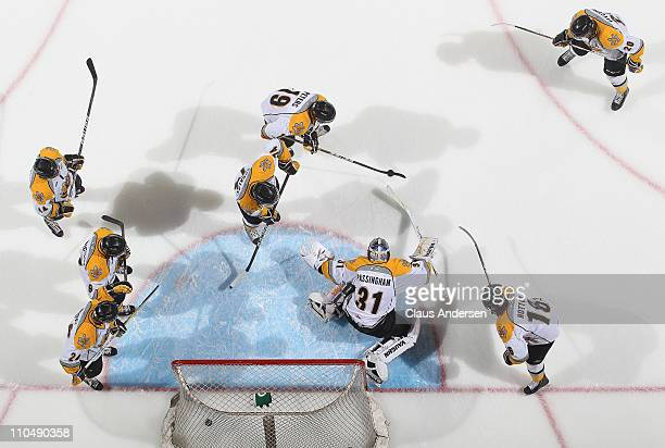 The Sarnia Sting practice a shooting drill in the warm-up prior to a game against the London Knights on March 18, 2011 at the John Labatt Centre in...