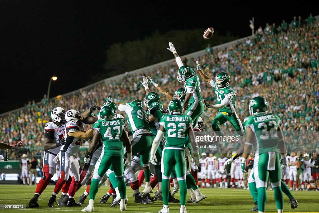 The Saskatchewan Roughrider defence tries to block a field goal attempt in the game between the Ottawa Redblacks and the Saskatchewan Roughriders at Mosaic Stadium on July 22, 2016 in Regina, Canada.
