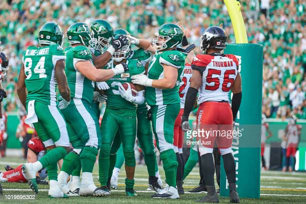 The Saskatchewan Roughriders celebrate after Nick Marshall of the Saskatchewan Roughriders scored a touchdown in the game between the Calgary...