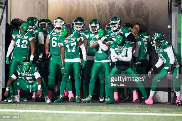 The Saskatchewan Roughriders prepare to take the field wearing masks for Halloween for the game between the Montreal Alouettes and Saskatchewan...