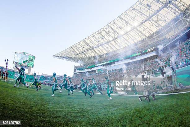 The Saskatchewan Roughriders take the field for the game between the Winnipeg Blue Bombers and Saskatchewan Roughriders at Mosaic Stadium on July 1...