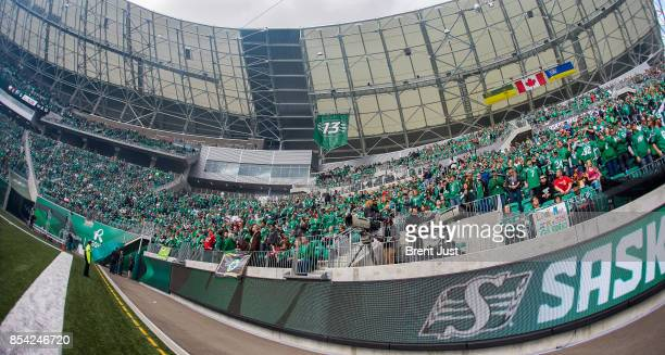 The Saskatchewan Roughriders unveil their 13th man banner before the game between the Calgary Stampeders and Saskatchewan Roughriders at Mosaic...