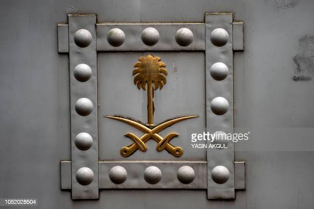 The Saudi Arabia emblem is seen on the doors of an entrance of the Saudi consulate in Istanbul on October 13 2018 Saudi Arabia dismissed on Octiber...